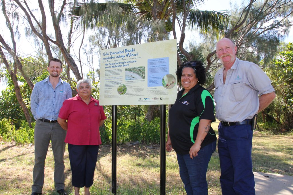 ) Senior Project Officer at Fitzroy Basin Association Shannon van Nunen, Darumbal Elder Nyoka Hatfield, Kristina Hatfield of Darumbal Enterprises and Paddy Delalande from Livingstone Shire Council unveil the new sign at Mulambin Beach (Manuwi).
